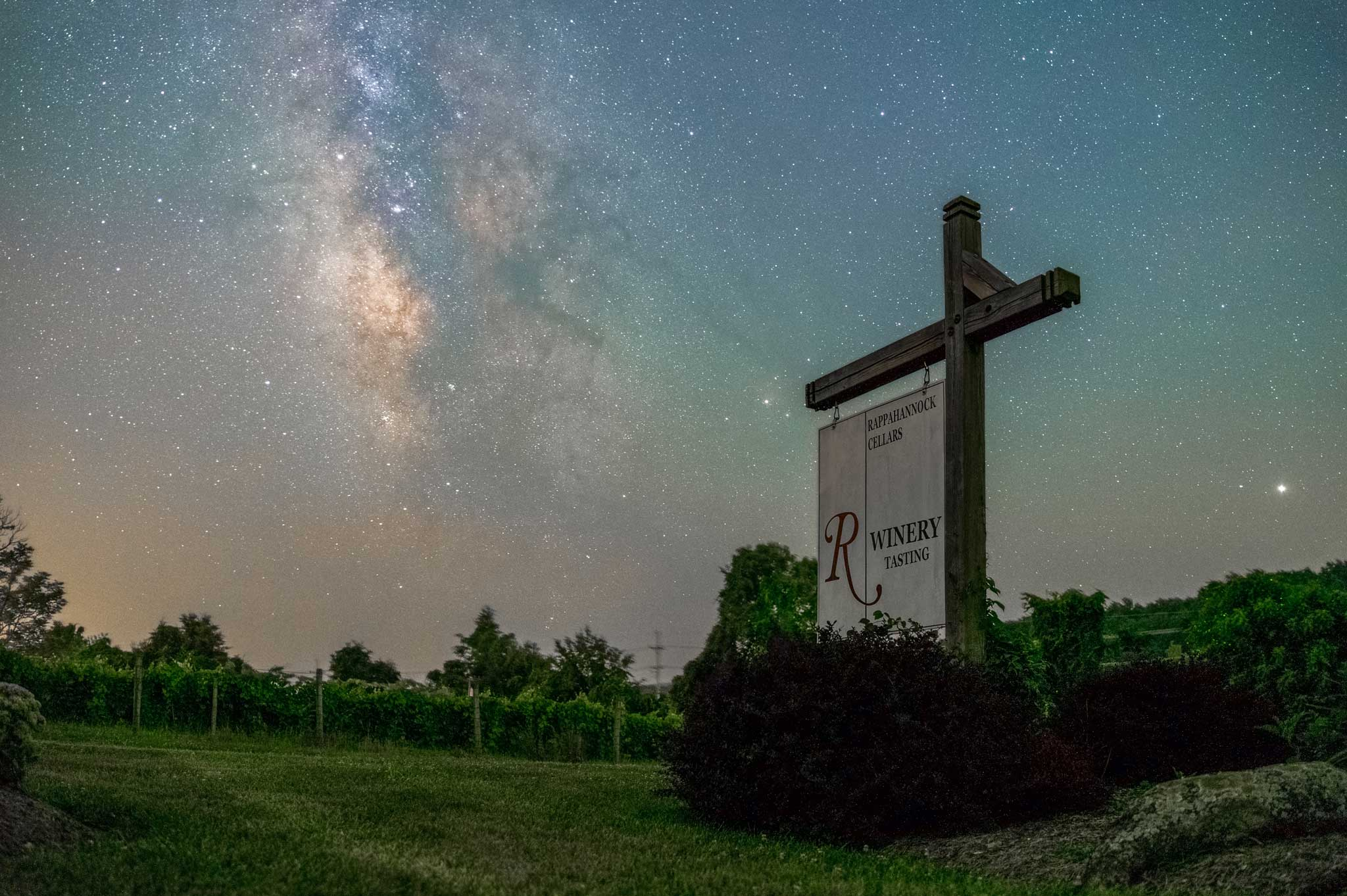 Rappahannock Cellars Winery Sign at driveway with Milky way visible in night sky